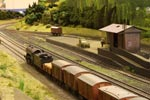Newcastleton, A K3 on a goods train passes the goods shed.